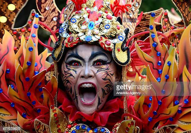 Participants wearing traditional batik clothes attend the Solo Batik Carnival on June 13 2015 in Surakarta Central Java Indonesia