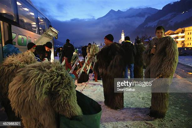 Participants who arrived by bus dress as the Krampus creature prior to Krampus night on November 30 2013 in Neustift im Stubaital Austria Sixteen...
