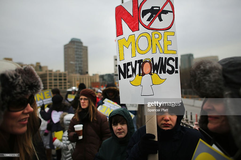 Participants with One Million Moms for Gun Control, a gun control group formed in the wake of last month's massacre at a Newtown, Connecticut elementary school, holds a rally and march across the Brooklyn Bridge on January 21, 2013 in New York City. The group marched to City Hall where they held a rally and demanded stricter measures against guns. One Million Moms for Gun Control said the event is inspired by the Rev. Martin Luther King Jr.'s message of nonviolence.