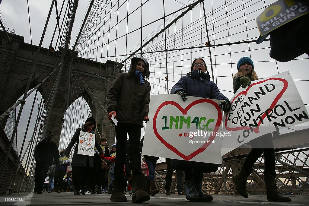 Participants with One Million Moms for Gun Control, a gun control group formed in the wake of last month's massacre at a Newtown, Connecticut elementary school, attend a rally and march across the Brooklyn Bridge on January 21, 2013 in New York City. The group marched to City Hall where they held a rally and demanded stricter measures against guns. One Million Moms for Gun Control said the event is inspired by the Rev. Martin Luther King Jr.'s message of nonviolence.