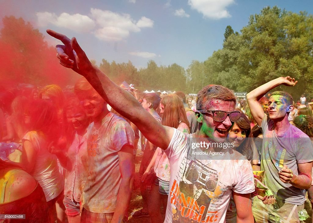 Participants with their faces and bodies painted with colors enjoy during the 'Holi olor Fest UA' in Kiev, Ukraine on June 25, 2016.