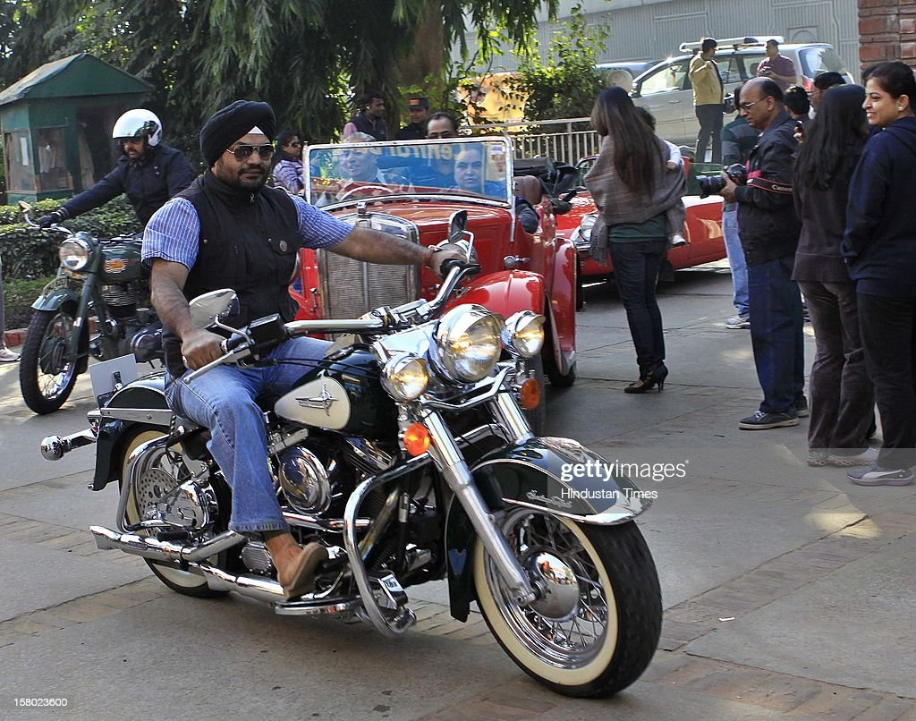 Participants with their Vintage Vehicles during the '21 Gun Salute Vintage Rally' on December 9, 2012 in New Delhi, India.