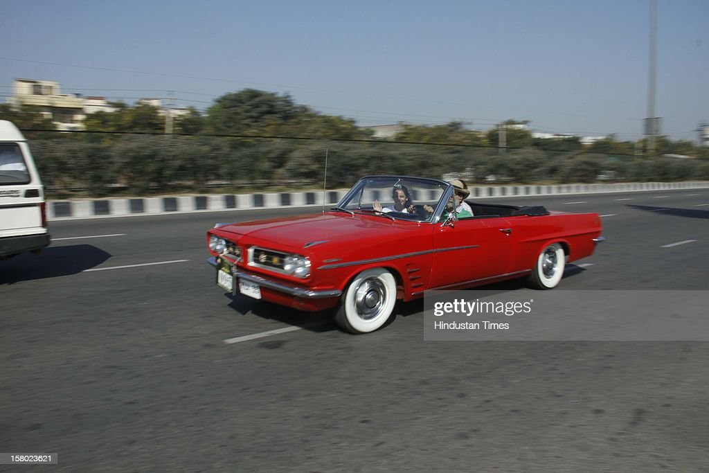 Participants with their Vintage Vehicles during the '21 Gun Salute Vintage Rally' on December 9, 2012 in Gurgaon, India.