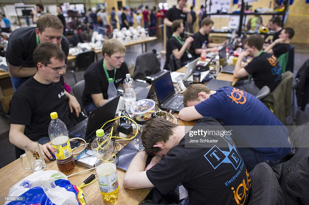 Participants work at their computer at the 2013 RoboCup German Open tournament on April 26, 2013 in Magdeburg, Germany. The three-day tournament is hosting 43 international teams and 158 German junior teams that compete in a variety of disciplines, including soccer, rescue and dance.