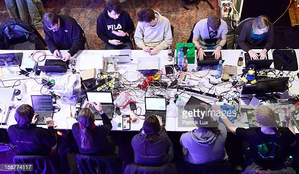 Participants work at their laptops at the annual Chaos Computer Club computer hackers' congress called 29C3 on December 28 2012 in Hamburg Germany...