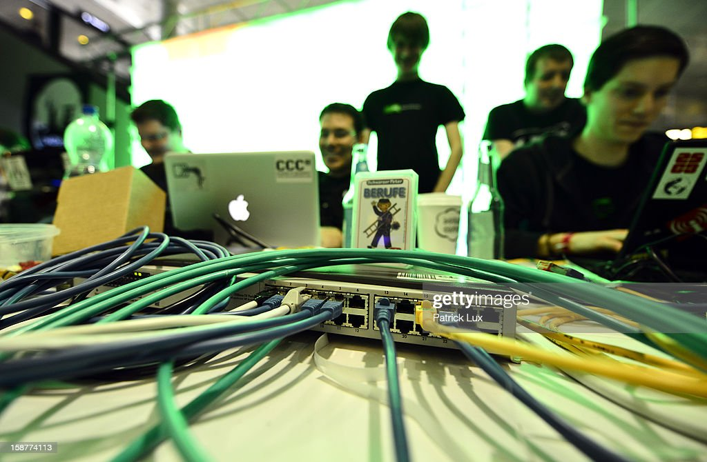 Participants work at their their laptops at the annual Chaos Computer Club (CCC) computer hackers' congress, called 29C3, on December 28, 2012 in Hamburg, Germany. The 29th Chaos Communication Congress (29C3) attracts hundreds of participants worldwide annually to engage in workshops and lectures discussing the role of technology in society and its future.