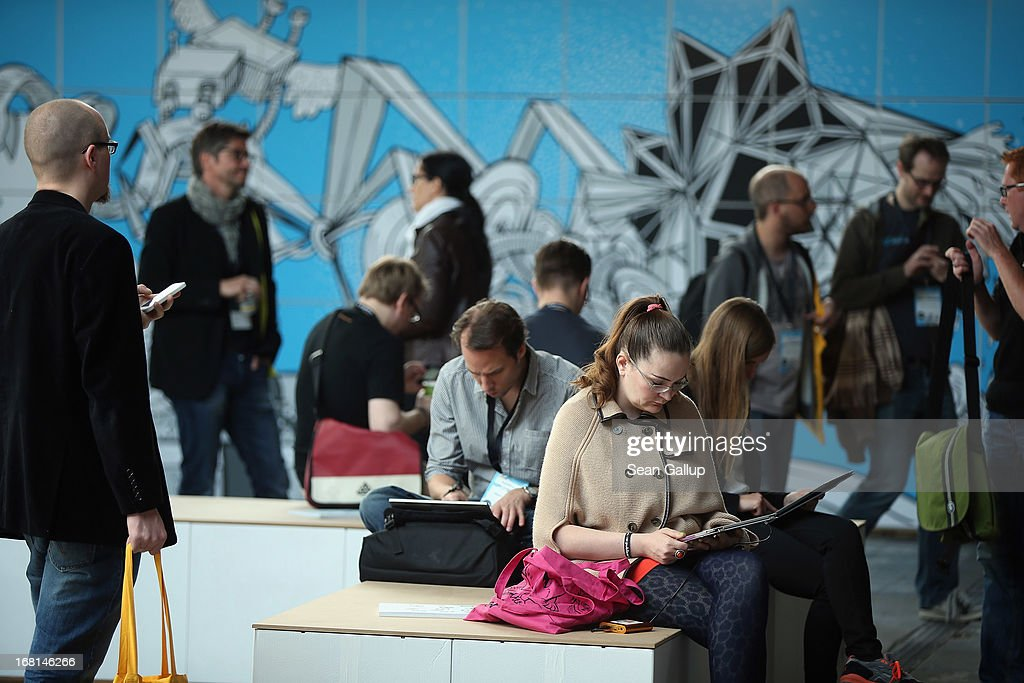 Participants work on computers, tablets and other digital devices in between conferences on the first day of the re:publica 2013 conferences on May 6, 2013 in Berlin, Germany. Re:publica, a three-day-event, brings together bloggers and digitial media professionals for a series of conferences on affecting social, political and economic change through the Internet.