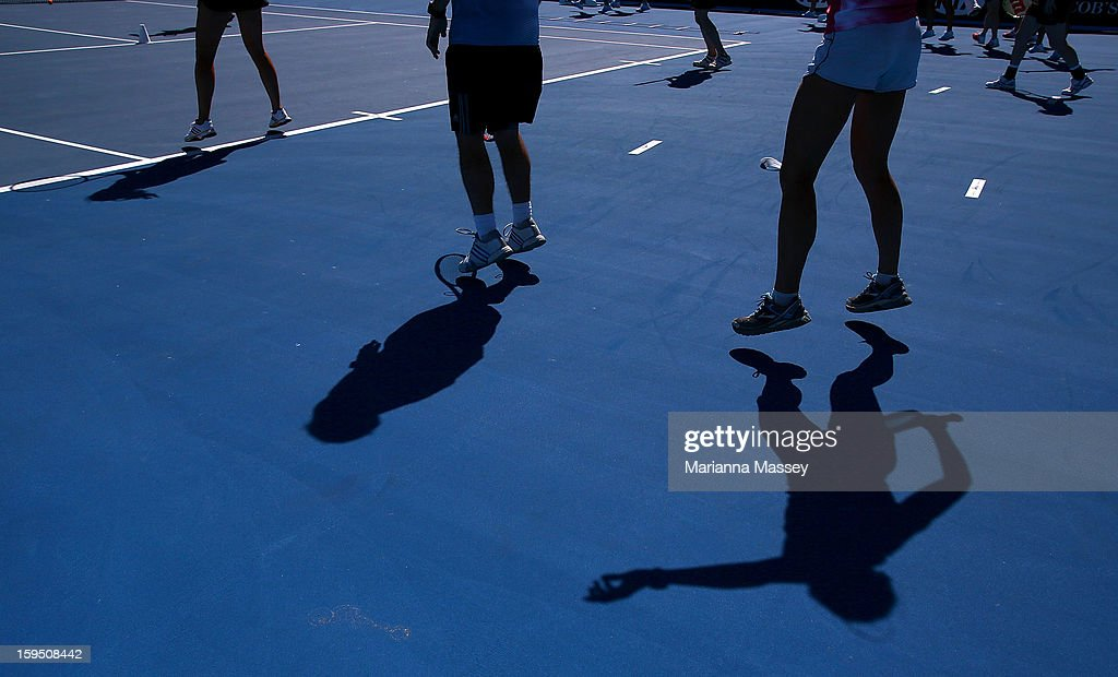 Participants work up a sweat during the pre-match Cardio Tennis workout on Margaret Court during day two of the 2013 Australian Open at Melbourne Park on January 15, 2013 in Melbourne, Australia.