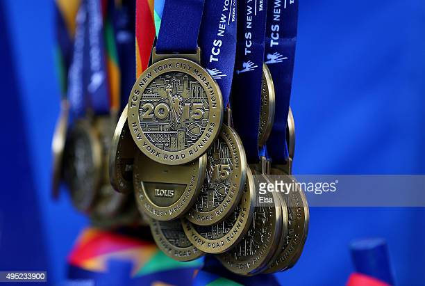 Participation medals hang at the finish line of the TCS New York City Marathon on November 1 2015 in New York City