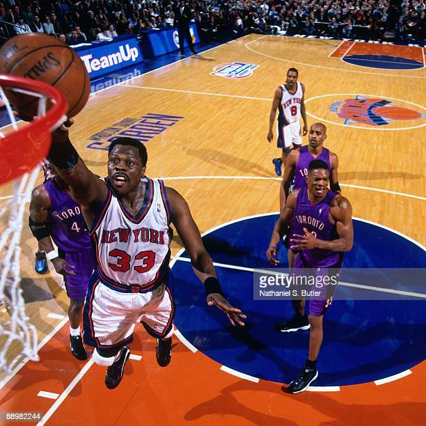 Partick Ewing of the New York Knicks shoots a layup against the Toronto Raptors in Game Two of the Eastern Conference Quarterfinals during the 2000...