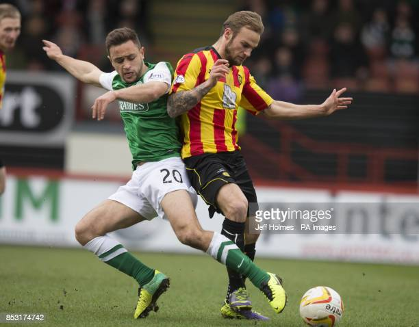 Partick Thistle's Kallum Higginbotham and Hibernian's Tom Taiwo during the Scottish Premier League match at Firhill Stadium Glasgow