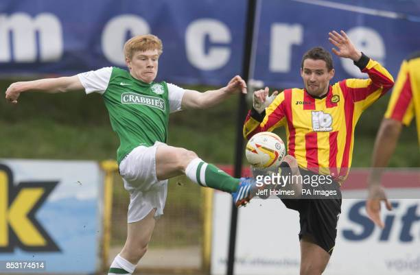 Partick Thistle's Lee Mair and Hibernian's Jason Cummings during the Scottish Premier League match at Firhill Stadium Glasgow