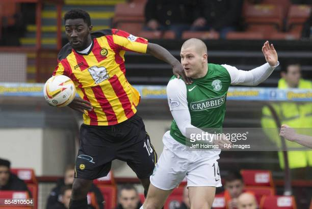 Partick Thistle's Prince Buaben and Hibernian's James Collins during the Scottish Premier League match at Firhill Stadium Glasgow