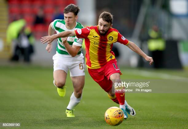 Partick Thistle's Steven Lawless and Celtic's Kieran Tierney battle for the ball during the Ladbrokes Scottish Premiership match at Firhill Stadium...
