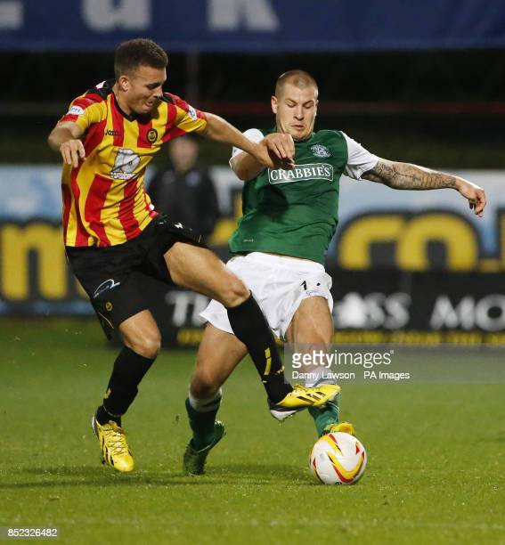 Partick's Thistle's Aaron TaylorSinclair and Hibernian's James Collins battle for the ball during the Scottish Premiership match at Firhill Stadium...