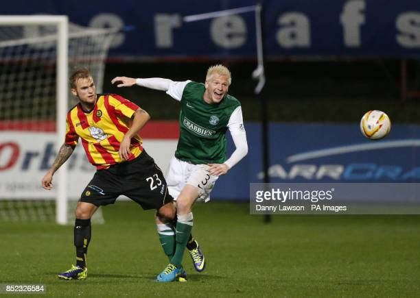 Partick's Thistle's Kallum Higginbotham and Hibernian's yan McGivern battle for the ball during the Scottish Premiership match at Firhill Stadium...