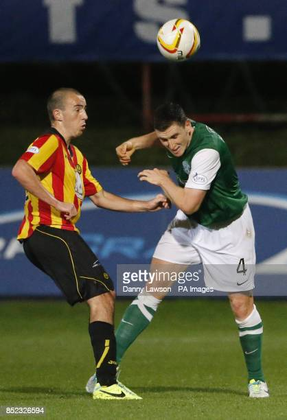Partick's Thistle's Stuart Bannigan and Hibernian's Paul Hanlon battle for the ball during the Scottish Premiership match at Firhill Stadium Glasgow