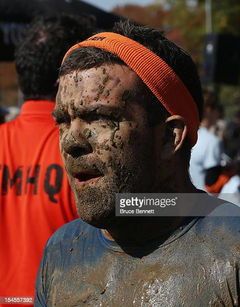 A particpant competes in the Tough Mudder event at Raceway Park on October 20 2012 in Englishtown New Jersey