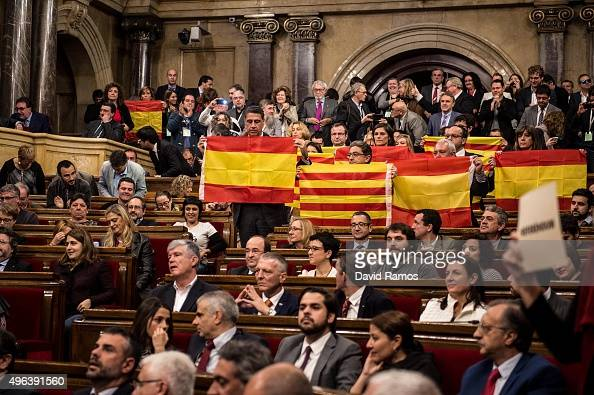 Partido Popular de Catalunya members of Catalan parliament hold Spanish flags at the end of the parliamentary session on November 9 2015 in Barcelona...