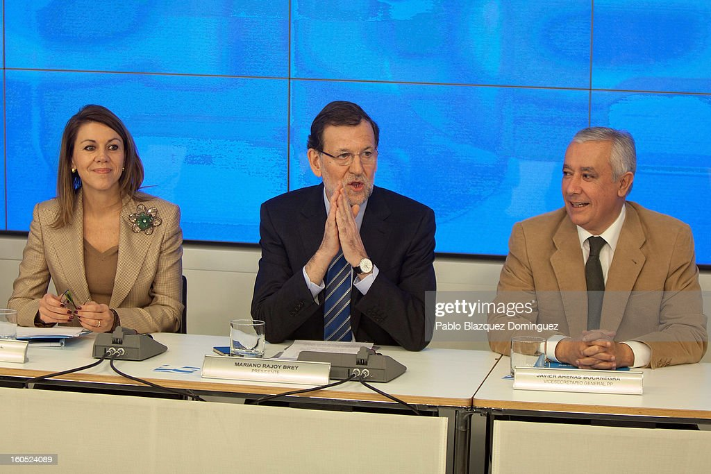 Partido Popular general secretary Maria Dolores de Cospedal, Spanish Prime Minister Mariano Rajoy and PP vice secretary Javier Arenas attend a PP national executive comitee on February 2, 2013 in Madrid, Spain. Spanish reports alleged Rajoy and other conservative politicians received regular payments from a previously undisclosed account run by the treasurers of his Popular Party from 1990 to 2008.