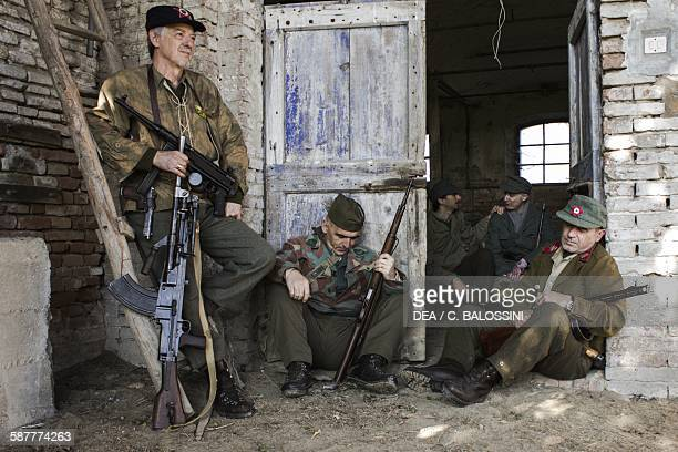 Partisans hiding in a farmhouse in the Bonizzo countryside Italian front Second World War 20th century Historical reenactment