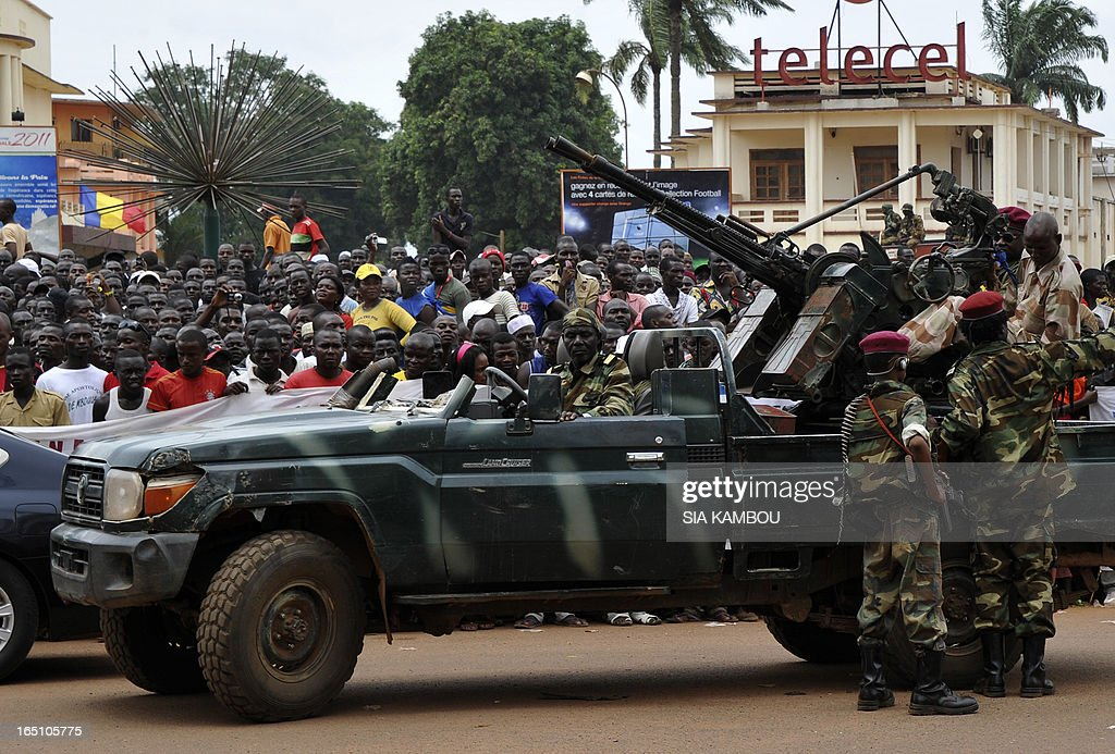Partisans of new Central African Republic leader Michel Djotodia cheer the arrival of rebel Seleka coalition soldiers in Bangui on March 30, 2013. The Central African Republic's new strongman Michel Djotodia vowed Saturday not to contest 2016 polls and hand over power at the end of the three-year transition he declared after his coup a week ago.