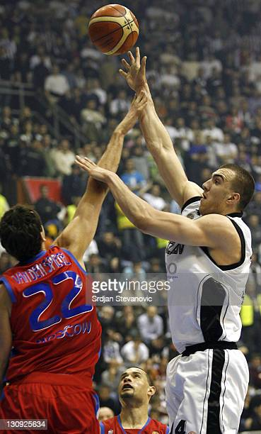 Partizan Belgrade Nikola Pekovic right tries to score over Thomas Van Den Spiegel left from CSKA Moscow during the TOP 16 group E Euroleague match in...