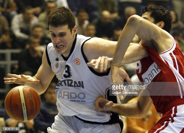 Partizan Belgrade player Kosta Perovic left is challanged by Ioannis Bourousis right from Olympiacos Athens during the TOP 16 group E Euroleague...