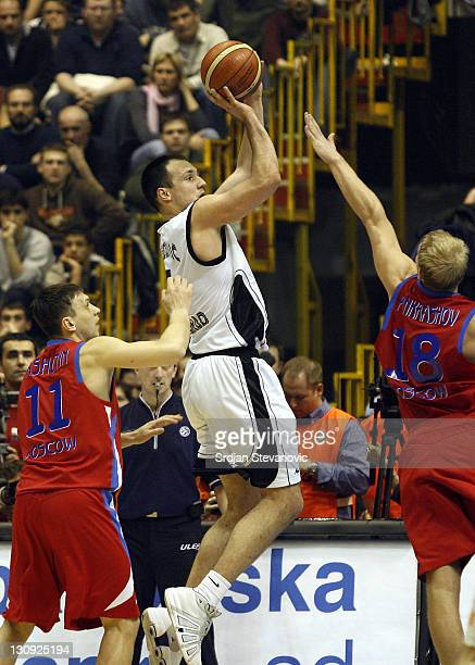 Partizan Belgrade player Luka Bogdanovic center against Anton Ponkrashov right and Zakhar Pashutin left from CSKA Moscow during the TOP 16 group E...