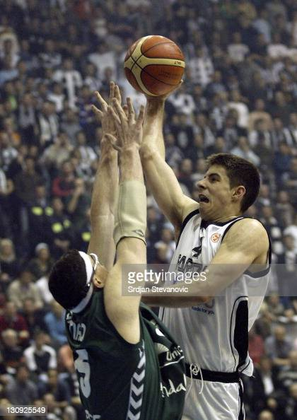 Partizan Belgrade player Milenko Tepic right try to score over Daniel Santiago left from Unicaja Malaga during a group B Euroleague basketball match...
