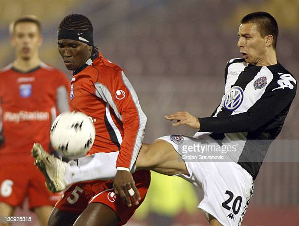 Partizan Belgrade player Nebojsa Marinkovic right shoot the ball near Oumar Kalabane left from Auxerre during Uefa Cup Group A match between Partizan...