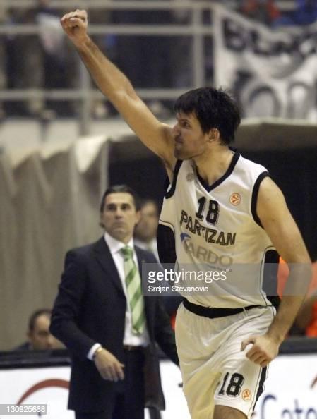 Partizan Belgrade player Predrag Drobnjak rightcelebrate near Unicaja head coach Sergio Scariolo left during their group B Euroleague basketball...