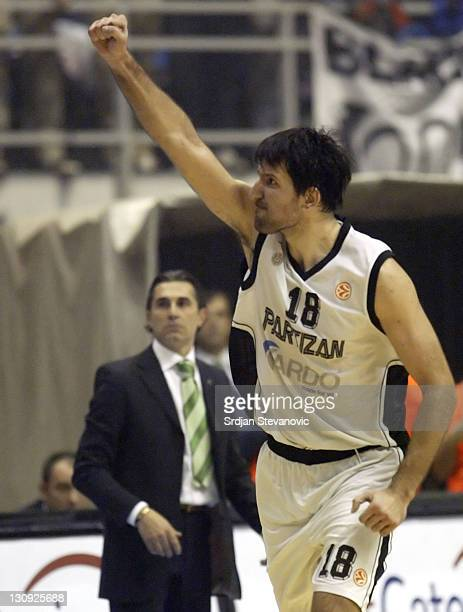 Partizan Belgrade player Predrag Drobnjak rightcelebrate near Unicaja head coach Sergio Scariolo left during their group B Euroleague basketball...