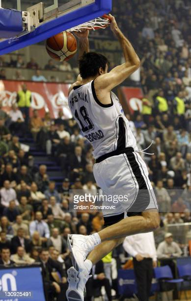 Partizan Belgrade player Predrag Drobnjak slam dunks behind the back during the TOP 16 group E Euroleague basketball match in Belgrade Serbia on...