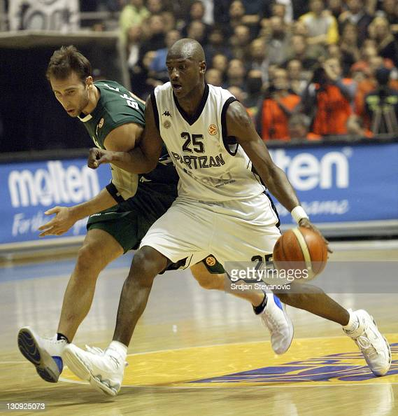 Partizan Belgrade player Vonteego Cummings right is challanged by Pepe Sanchez left from Unicaja Malaga during a group B Euroleague basketball match...
