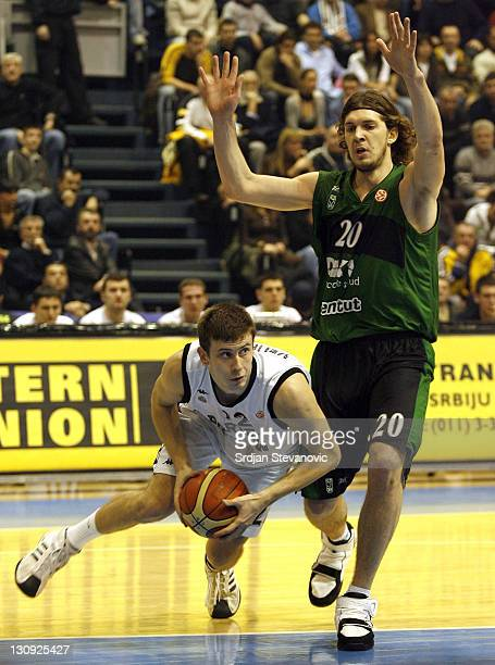 Partizan player Novica Velickovic left tries to assist near Flis Dmitri right from Joventut Spain during a group B Euroleague basketball match...