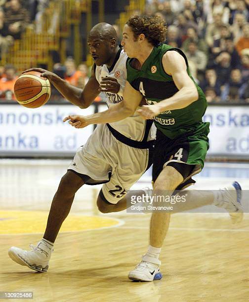 Partizan player Vonteego Cummings left is challanged by Huertas Marcelo right from Joventut Spain during a group B Euroleague basketball match...