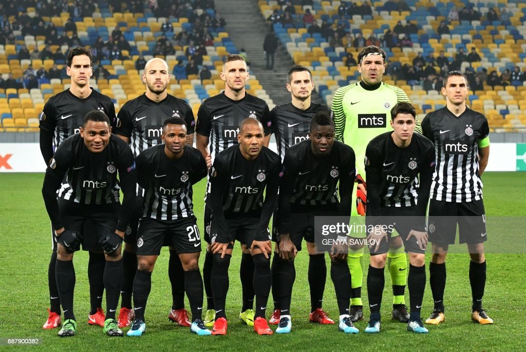 Partizan's players pose prior to the UEFA Europa League Group B football match between Dynamo Kiev and Partizan Belgrade on December 7, 2017, at the Olympic Stadium in Kiev. /