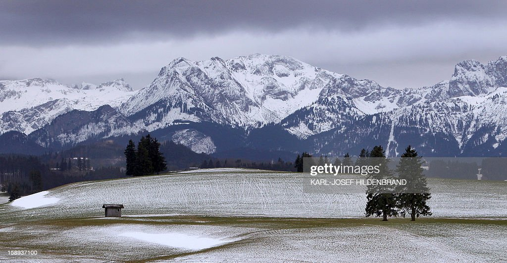 Partly snow covered mountains are seen near Enisried, southern Germany, on January 3, 2013. Meteorologists forecast rainy weather with temperatures around six degrees for southern Germany. AFP PHOTO / KARL-JOSEF HILDENBRAND GERMANY OUT