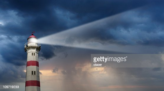 Partly sunlit lighthouse, bad weather in background
