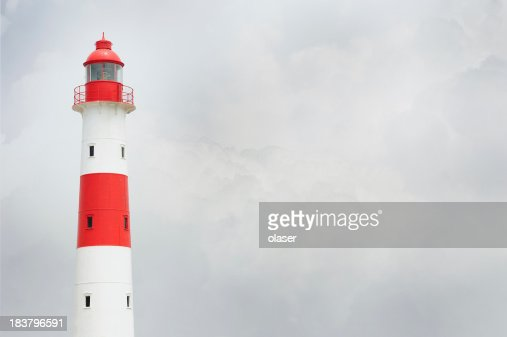 'Partly sunlit lighthouse, bad weather in background'