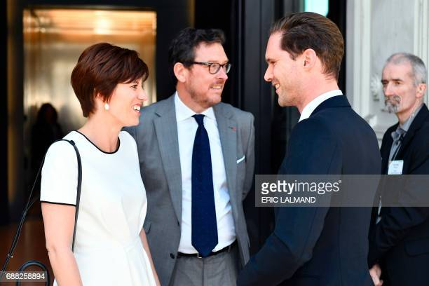 Partner of Belgium's prime minister Amelie Derbaudrenghien greets husband of Luxembourg's prime minister Gauthier Destenay during a visit to the...