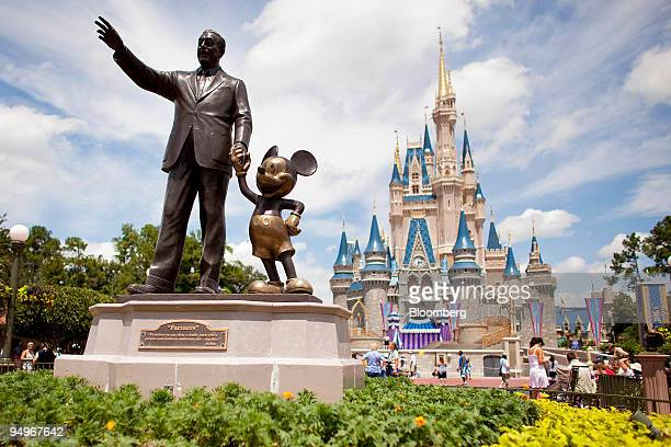 'Partners' a statue of Walt Disney and Mickey Mouse sits in front of Cinderalla Castle at Magic Kingdom part of the Walt Disney World theme park and...