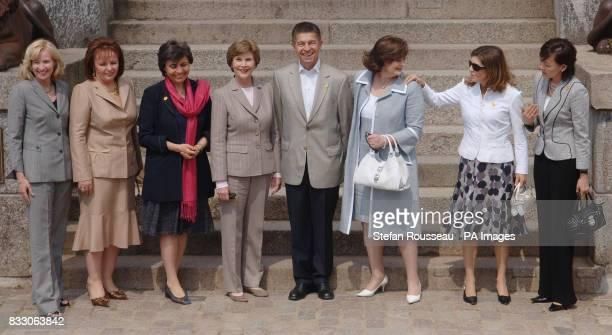 Partners of G8 leaders from left Laureen Harper Ludmila Putina Flavia Prodi Laura Bush Joachim Sauer Cherie Blair Margarida Uva and Alie Abe visit...