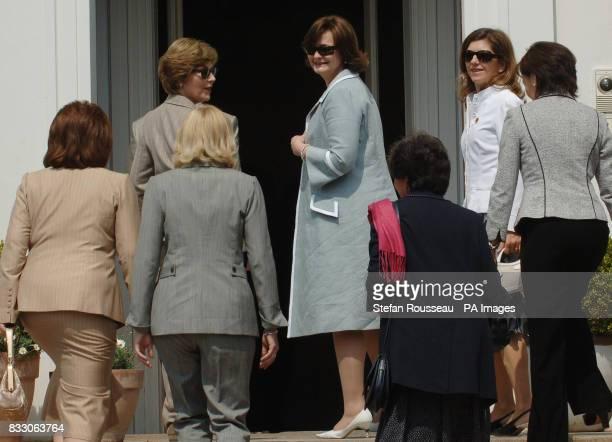 Partners of G8 leaders from left Ludmila Putina Laura Bush Laureen Harper Cherie Blair Flavia Prodi Margarida Uva and Alie Abe visit Schlosshotel...