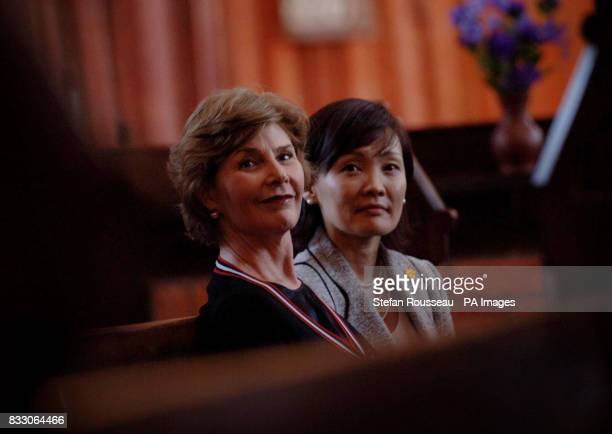 Partners of G8 leaders Laura Bush and Akie Abe look around St Nicholas's Church in the historical town of Wismar on the first day of the G8 Summit in...
