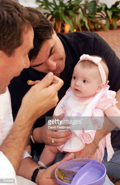 Partners Rob Flint and Kevin Burns play with their 5monthold adopted daughter Autumn Hope March 14 2002 while taking a walk along Lincoln Road in...