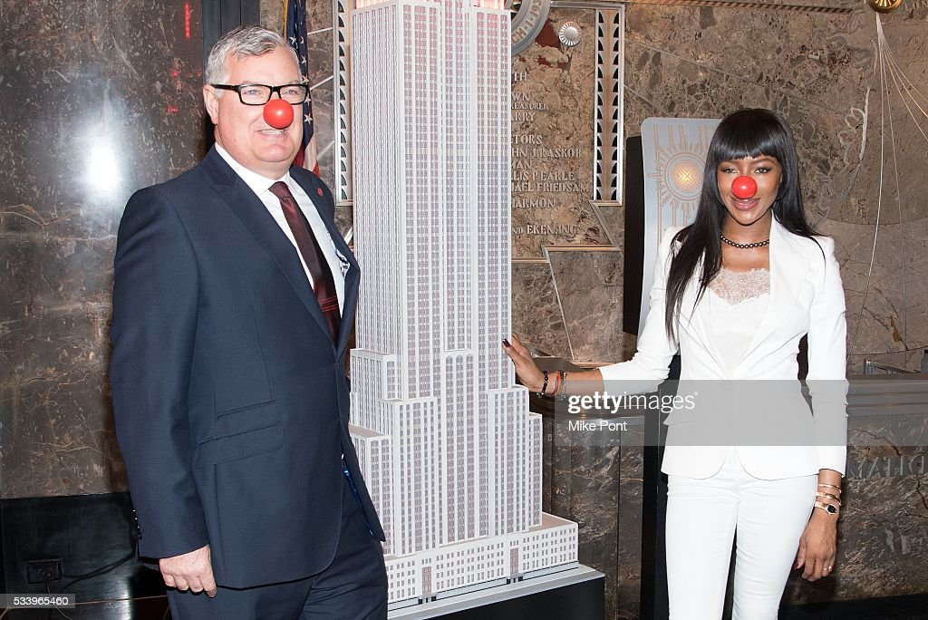 VP Partnerships of Red Nose Day <a gi-track='captionPersonalityLinkClicked' href=/galleries/search?phrase=Terry+Mills&family=editorial&specificpeople=235943 ng-click='$event.stopPropagation()'>Terry Mills</a> and <a gi-track='captionPersonalityLinkClicked' href=/galleries/search?phrase=Naomi+Campbell&family=editorial&specificpeople=171722 ng-click='$event.stopPropagation()'>Naomi Campbell</a> light The Empire State Building in honor of Red Nose Day on May 24, 2016 in New York City.