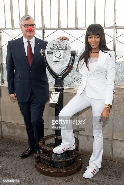 Partnerships of Red Nose Day Terry Mills and Naomi Campbell light The Empire State Building in honor of Red Nose Day on May 24 2016 in New York City