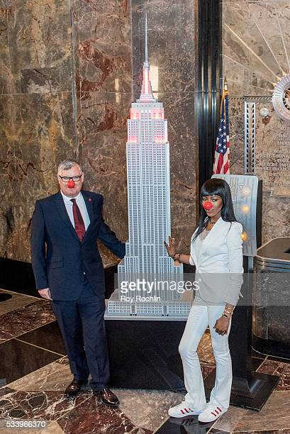Partnerships of Red Nose Day Terry Mills with model Naomi Campbell as she Lights Empire State Building on May 24 2016 in New York City